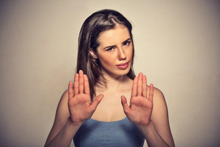 Woman Signalling Stop