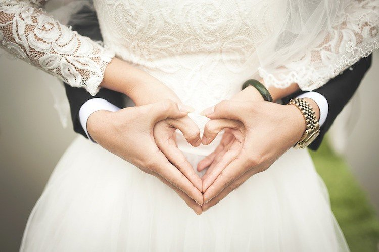 Wedding Timeline - Bride and Groom Creating Heart With Hands
