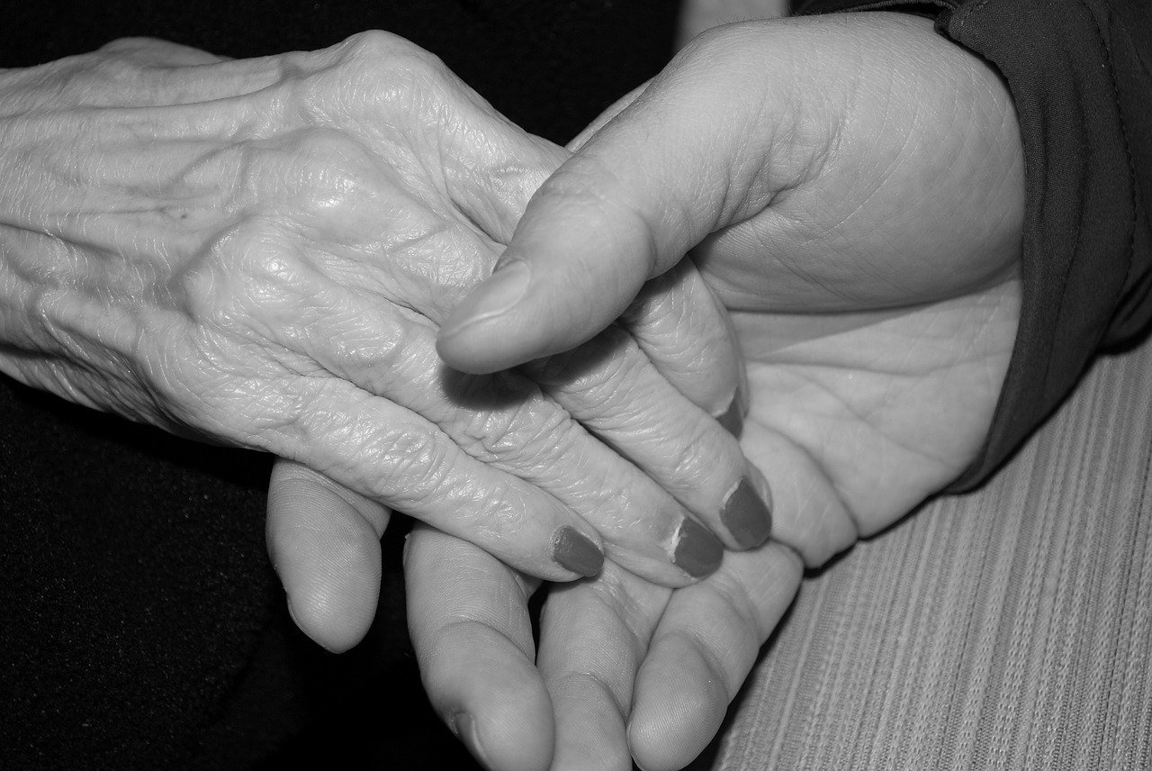Random Acts of Kindness Campaign | Young Hand Holding Old Hand