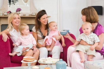 Mothers Drinking Tea at Play Date With Babies