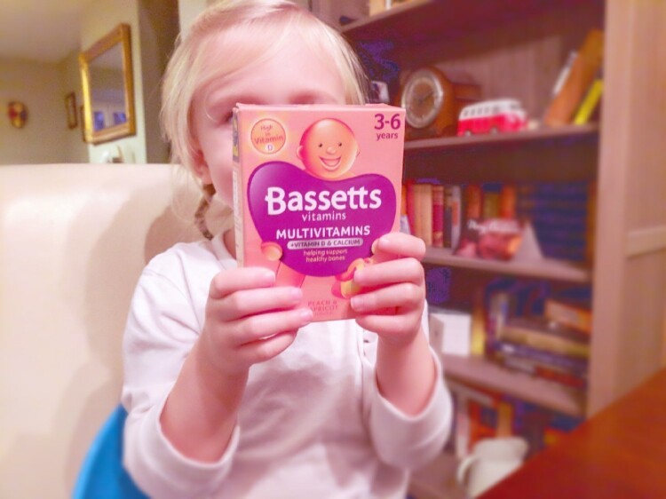 Baby and Toddler Product Reviews - Girl Holding Vitamins Box