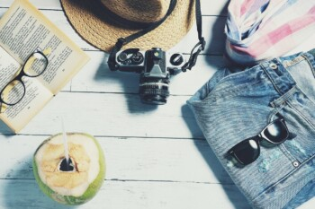 What to pack for a family holiday abroad - hate, camera, sunglasses