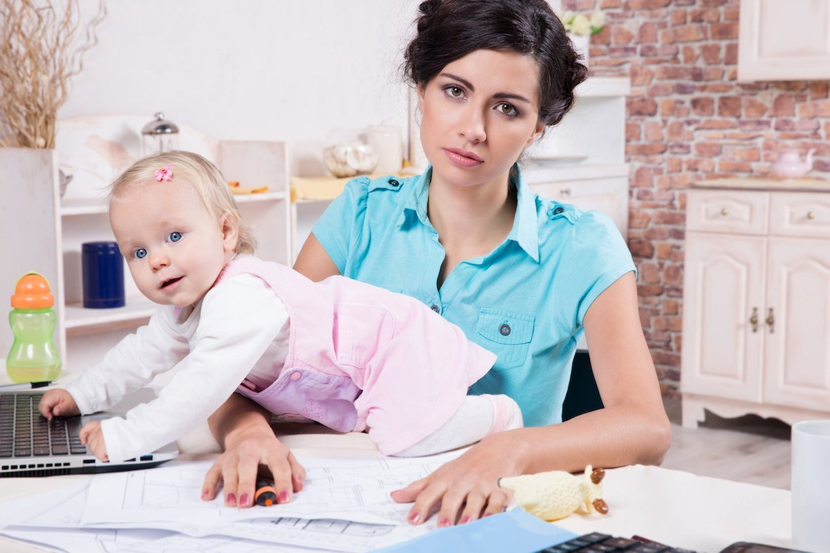 Woman with Baby Climbing on Laptop - The Reality of Being a WAHM