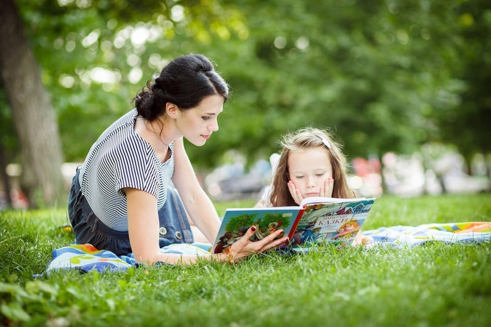 Mother and Daughter Reading in Garden