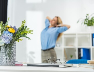 Woman Stretching in Office