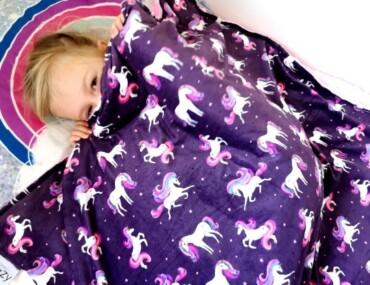 Child With Sensory Weighted Blanket