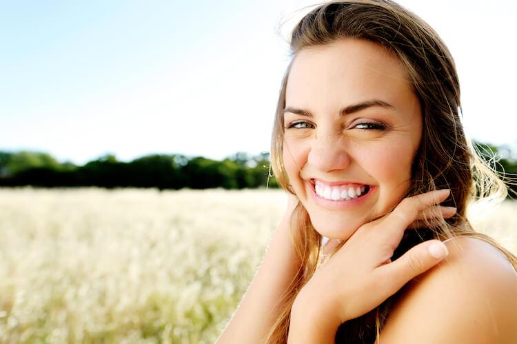 Woman Smiling in a corn field.