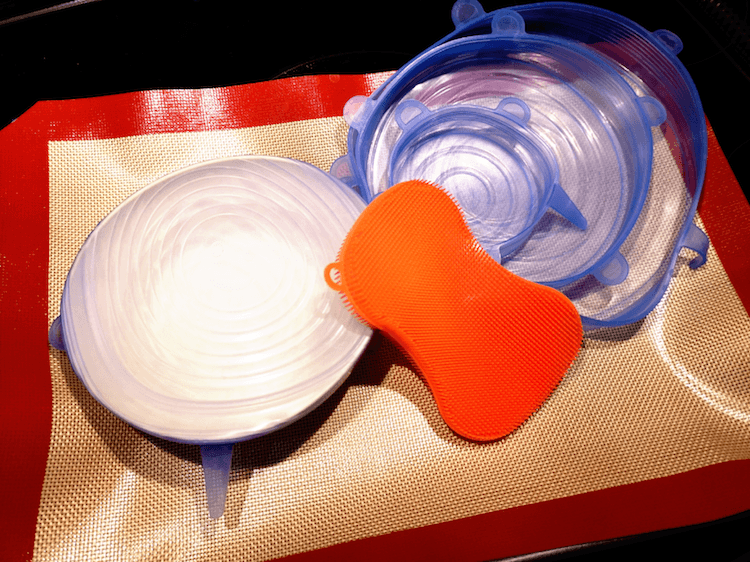 Close Up of Silicone Eco Kitchen Swaps comprising Silicone Lids, Silicone Tray Liners, and a Silicone Sponge
