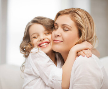Mother and Young Daughter Embracing