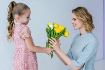 Choose Kindness - Girl Giving Flowers to Her Mother