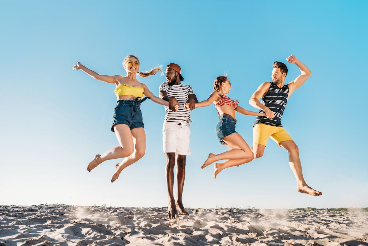 You are responsible for your own happiness. Positive mental attitude | Surround yourself with positive people. Image shows a group of young adults jumping for joy.