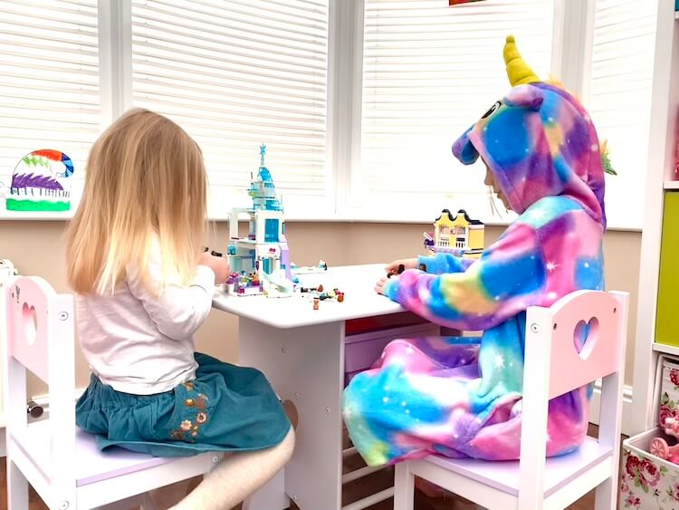 Two girls playing Lego.