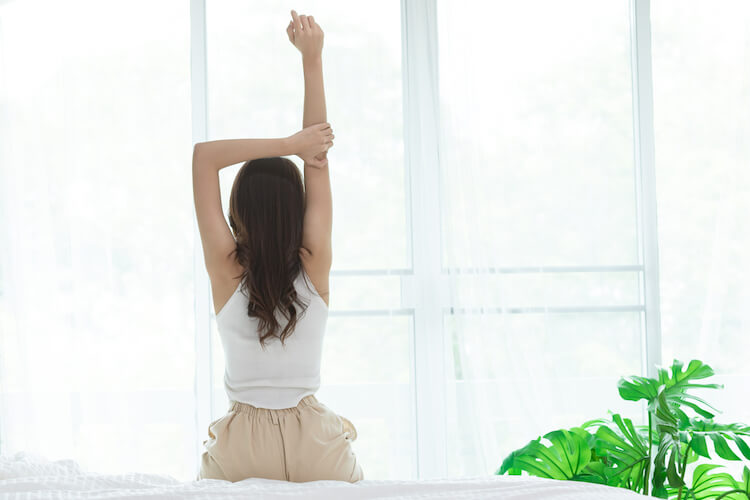 Back view of a woman stretching in the morning.