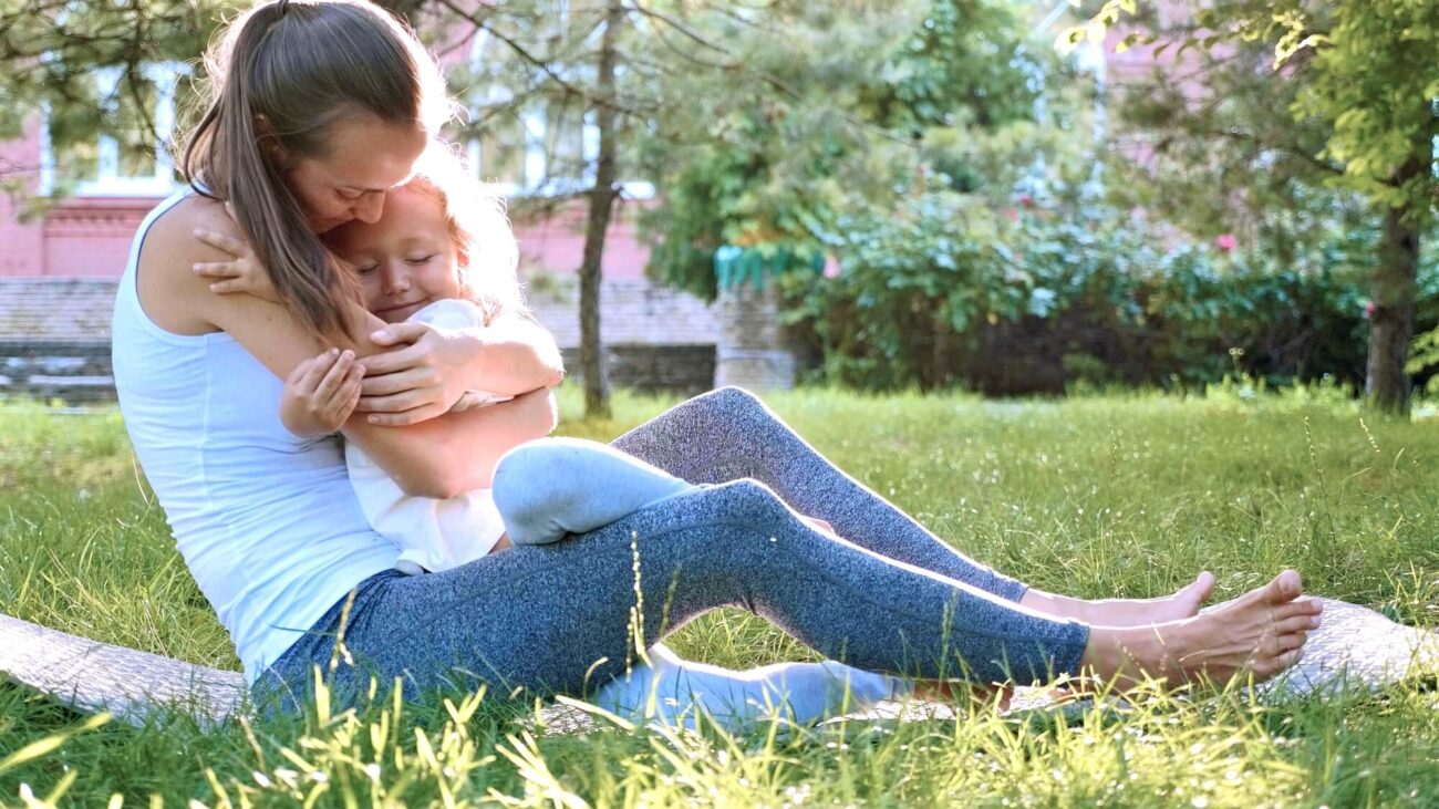 Inner child meditation | Image shows a woman comforting a small child.