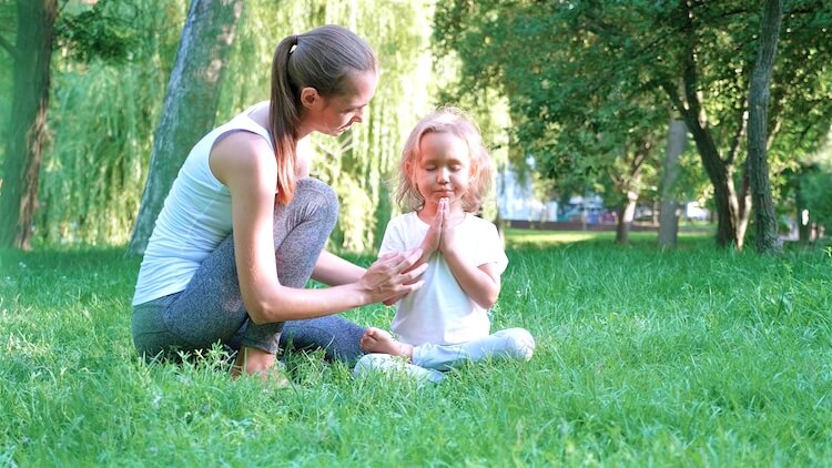 Reparenting meditation | Image shows a woman comforting a small girl.