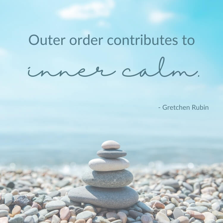Calm quote: Outer order contributes to inner calm. Background image shows zen stones in front of the ocean.