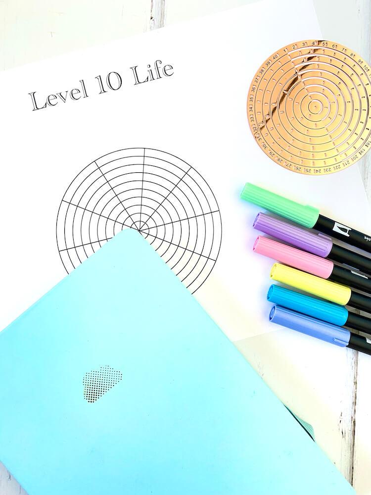 Level 10 life worksheet bullet journal flatlay.
