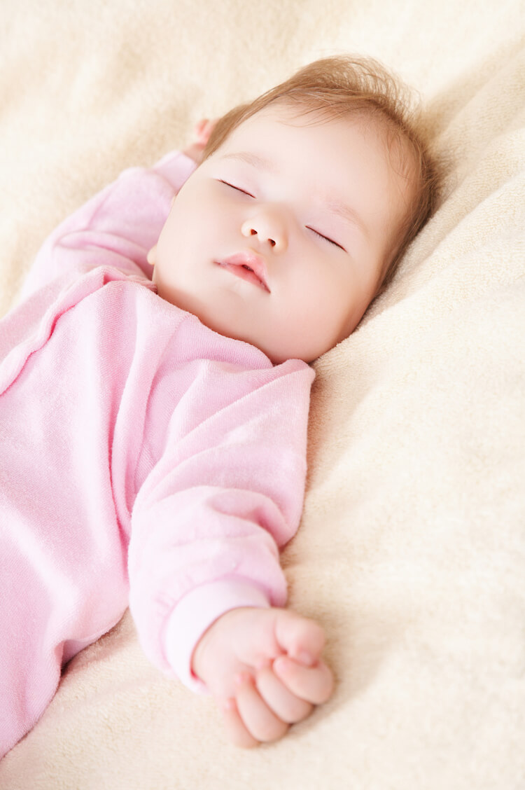 Image shows a baby sleeping.