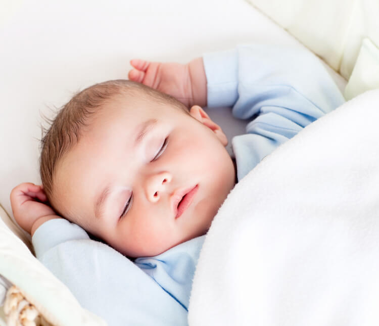 Image shows a sleeping infant.